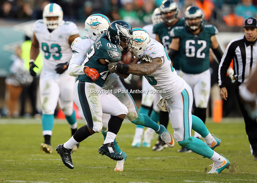 Philadelphia Eagles running back Darren Sproles (43) gets gang tackled by Miami Dolphins outside linebacker Koa Misi (55) and Miami Dolphins strong safety Reshad Jones (20) during the 2015 week 10 regular season NFL football game against the Miami Dolphins on Sunday, Nov. 15, 2015 in Philadelphia. The Dolphins won the game 20-19. (©Paul Anthony Spinelli)