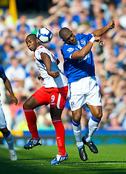 LIVERPOOL, ENGLAND - Sunday, September 20, 2009: Everton's Sylvain Distin and Blackburn Rovers' Jason Roberts during the Premiership match at Goodison Park. (Pic by David Rawcliffe/Propaganda)