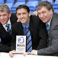 St Johnstone manager Owen Coyle (centre) pictured with the Bells Manager of the Month award for March. He is flanked by his assistant Jim Weir (left) and Chairman Geoff Brown who has today extended the contracts of Coyle and Weir.<br /> see story by Gordon Bannerman Tel: 01738 553978 or 07729 865788<br /> Picture by Graeme Hart.<br /> Copyright Perthshire Picture Agency<br /> Tel: 01738 623350  Mobile: 07990 594431