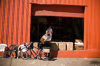 Brandon McGee loads his bike for deliveries in San Franicsco, Ca., on Monday, April 4, 2011. Bicycle Coffee Company is a San Francisco start-up taking green to a new level, by delivering hand-roasted coffee to over 100 local businesses, in addition to Whole Foods, by bicycle only. Lianne Milton for The Wall Street Journal.Bay Area - Coffee Status