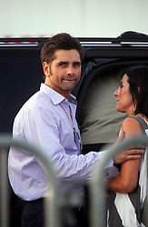 27 April 2012. New Orleans, Louisiana,  USA. .New Orleans Jazz and Heritage Festival. .Actor John Stamos leaves the Beach Boy's 50th anniversary tour kick off with unidentified woman (could it be Lea Marsh?).Photo; Charlie Varley.
