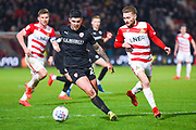 Alex Mowatt of Barnsley (27) and Alfie May of Doncaster Rovers (19) in action during the EFL Sky Bet League 1 match between Doncaster Rovers and Barnsley at the Keepmoat Stadium, Doncaster, England on 15 March 2019.