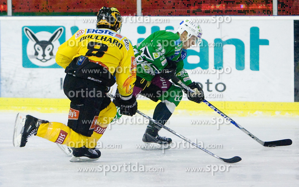 Francois Bouchard of Vienna vs Eric Pance of Olimpija during 52nd Round of EBEL league ice-hockey match between HDD Tilia Olimpija, Ljubljana and EV Vienna Capitals, on February 7, 2010 in Arena Tivoli, Ljubljana, Slovenia. Vienna defeated Olimpija 8-2. (Photo by Vid Ponikvar / Sportida)