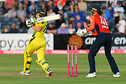 Alyssa Healy of Australia hits the ball to the boundary for four runs during the 3rd Vitality International T20 match between England Women Cricket and Australia Women at the Bristol County Ground, Bristol, United Kingdom on 31 July 2019.