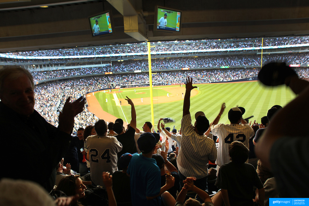 Yankees fans celebrate a Yankee home run during the New York Yankees V New York Mets Subway Series Baseball game at Yankee Stadium, The Bronx, New York. 8th June 2012. Photo Tim Clayton
