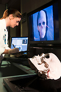 A scientist calibrates superimposition technology with a skull at the Joint POW/MIA Accounting Commands, or JPAC, central identification laboratory at Hickam Air Force Base on Oahu, Hawaii.  The superimposition technology is used to overlay photographs with skeletal remains to identify soldiers that have been missing in action. (Model Released)