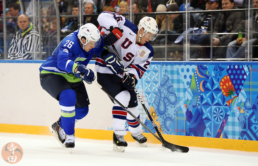 Feb 16, 2014; Sochi, RUSSIA; USA forward Paul Stastny (26) battles for the puck with Slovenia forward Jan Urbas (26) in a men's ice hockey preliminary round game during the Sochi 2014 Olympic Winter Games at Shayba Arena.