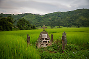 A stone cross shrine in a lush green paddy field flanked by hills and woods near Nongpoh, Ri-Bhoi district, Meghalaya, India. (photo by Andrew Aitchison / In pictures via Getty Images)