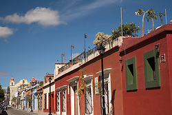 North America, Mexico, Oaxaca Province, Oaxaca, colorful shops and restaurants on typical street with Spanish colonial architecture