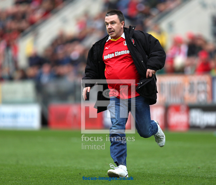 A Rotherham United fan invades the pitch after Fulham take the lead during the Sky Bet Championship match at the New York Stadium, Rotherham<br /> Picture by James Wilson/Focus Images Ltd 07709 548263<br /> 01/04/2017