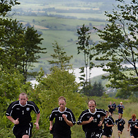 St Johnstone players back in pre-season training today, doing some tough hill running above Perth, pictured new signings Paul Lovering (left) and Brian McLaughlin (right) with Mark Reilly.<br />see story by Gordon Bannerman Tel: 07729 865788<br />Picture by Graeme Hart.<br />Copyright Perthshire Picture Agency<br />Tel: 01738 623350  Mobile: 07990 594431