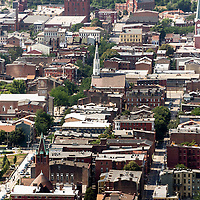Aerial photo of Cincinnati Over-The-Rhine neighborhood buildings and Churches facing North from downtown Cincinnati. Over-The-Rhine (OTR) is a Historic District and is listed on the US National Register of Historic Places. Photo is high resolution and was taken in 2012.