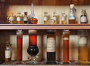 Shelves of liquid samples in glass bottles and vials, in the Musee Francois Tillequin – Collections de Matiere medicale, featuring laboratory collections of plants or parts of plants or animals used for medicinal purposes, at the former Ecole de Pharmacie de Paris, now the Faculte de Pharmacie at the Universite Paris Descartes, on the Avenue de l'Observatoire in the 6th arrondissement of Paris, France. The 25,000 samples were collected in the 18th, 19th and 20th centuries and the museum was opened in 1882. Picture by Manuel Cohen