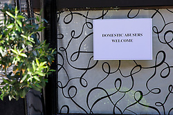 "© Licensed to London News Pictures. 08/06/2014. LONDON, UK. A sign left at the entrance of Scott's Restaurant in Mayfair reads ""Domestic abusers welcome"", photographed on Sunday. 8 June 2014. In June 2013, Nigella Lawson was pictured apparently being 'throttled' by Charles Saatchi at the same spot outside Scott's. Photo credit : Tolga Akmen/LNP"