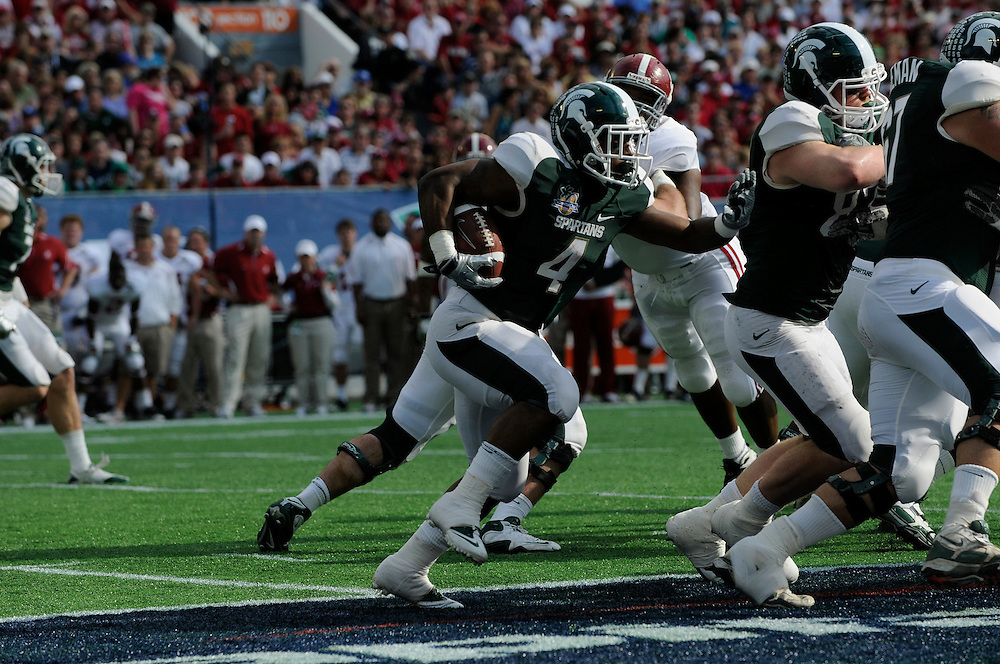 January 1, 2011: Edwin Baker of the Michigan State Spartans in action during the NCAA football game between MSU and the Alabama Crimson Tide at the 2011 Capital One Bowl in Orlando, Florida. Alabama defeated Michigan State 49-7.