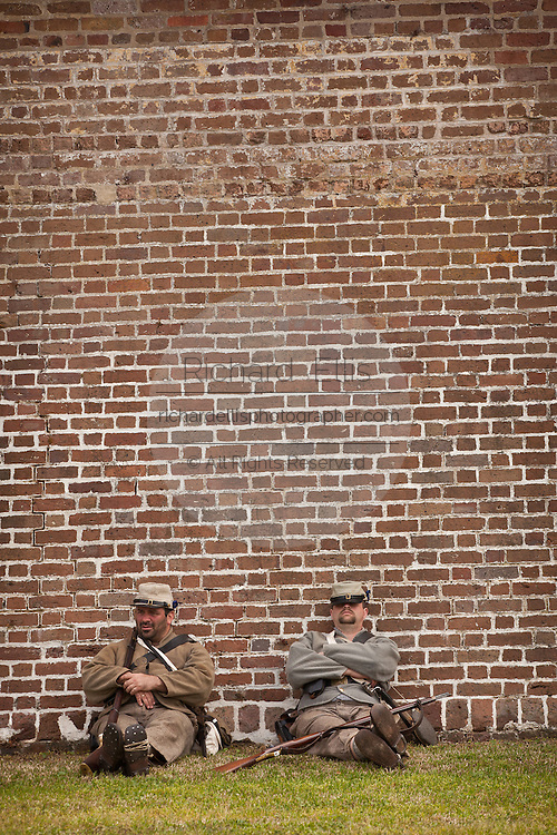 Confederate re-enactors relax on a hot day at Fort Moultrie Charleston, SC. The re-enactors are part of the 150th commemoration of the US Civil War.
