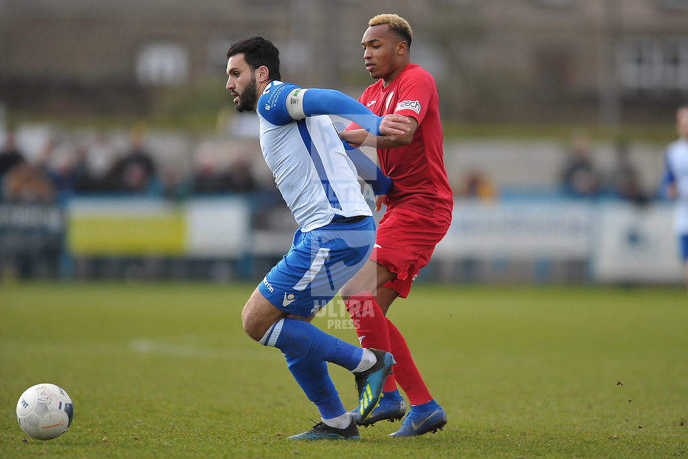 TELFORD COPYRIGHT MIKE SHERIDAN Marcus Dinanga of Telford battles for the ball with Hamza Bencherif during the Vanarama Conference North fixture between Guiseley and AFC Telford United at Nethermoor Park on Saturday, February 8, 2020.<br /> <br /> Picture credit: Mike Sheridan/Ultrapress<br /> <br /> MS201920-046