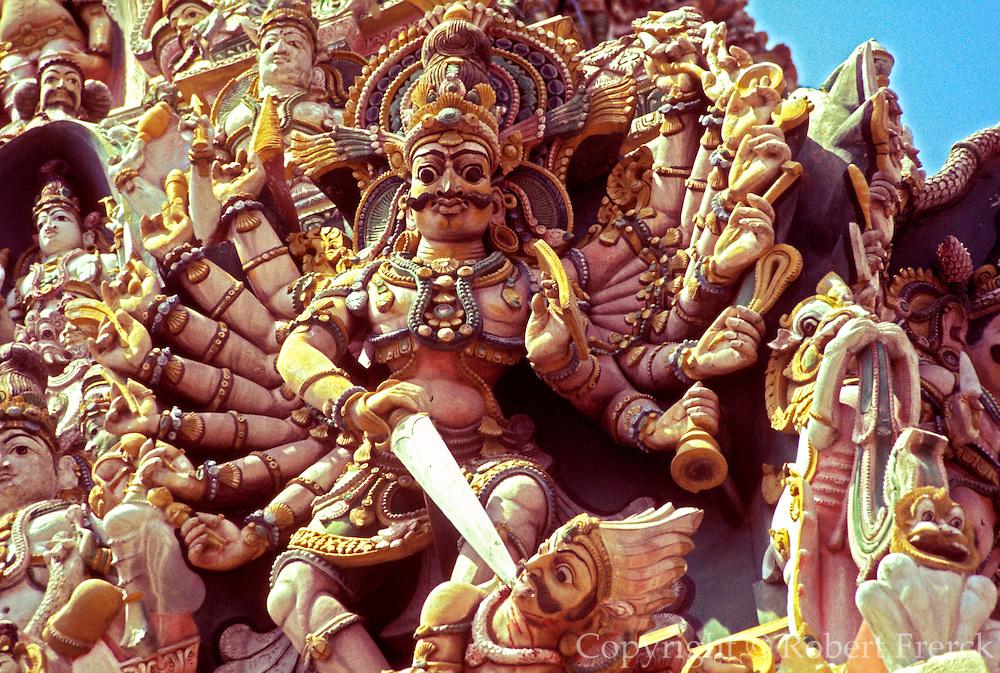 INDIA, RELIGION, HINDUISM Madurai; Meenakshi Hindu Temple; elaborately carved West Tower, detail showing Shiva