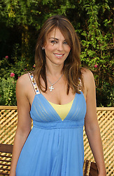 LIZ HURLEY at the Macmillan Cancer Support Dog Day held in the gardens of the Royal Hospital, Chelsea, London on 4th July 2006.<br />