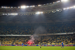 KIEV, UKRAINE - Easter Monday, March 28, 2016: Ukraine supporters set off smoke flares during the International Friendly match against Wales at the NSK Olimpiyskyi Stadium. (Pic by David Rawcliffe/Propaganda)