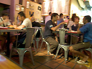 Young people together inside a small Mexican diner Miami Beach USA