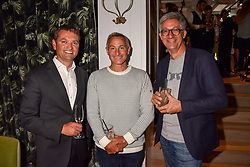 Left to right, Andrew Stembridge, Jeremy Goring and guest at a party to celebrate the launch of Hans' Bar & Grill, 11 Cadogan Gardens, Chelsea, London, England. 07 June 2018.