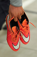 Robert Lewandowski's shoes in his hand before official training one day before the EURO 2016 qualifying match between Poland and Germany on October 10, 2014 at the National stadium in Warsaw, Poland<br /> <br /> Picture also available in RAW (NEF) or TIFF format on special request.<br /> <br /> For editorial use only. Any commercial or promotional use requires permission.<br /> <br /> Mandatory credit:<br /> Photo by © Adam Nurkiewicz / Mediasport