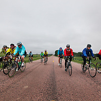 Karen Vanhaitsma (front row, left to right), Janna Muir, Jennie Gordon, Gary Schutjer (light blue), Melanie Peltz, Laurie Long and Bob Shriner ride towards Tea on Friday afternoon during the sixth day of the Tour de Kota.