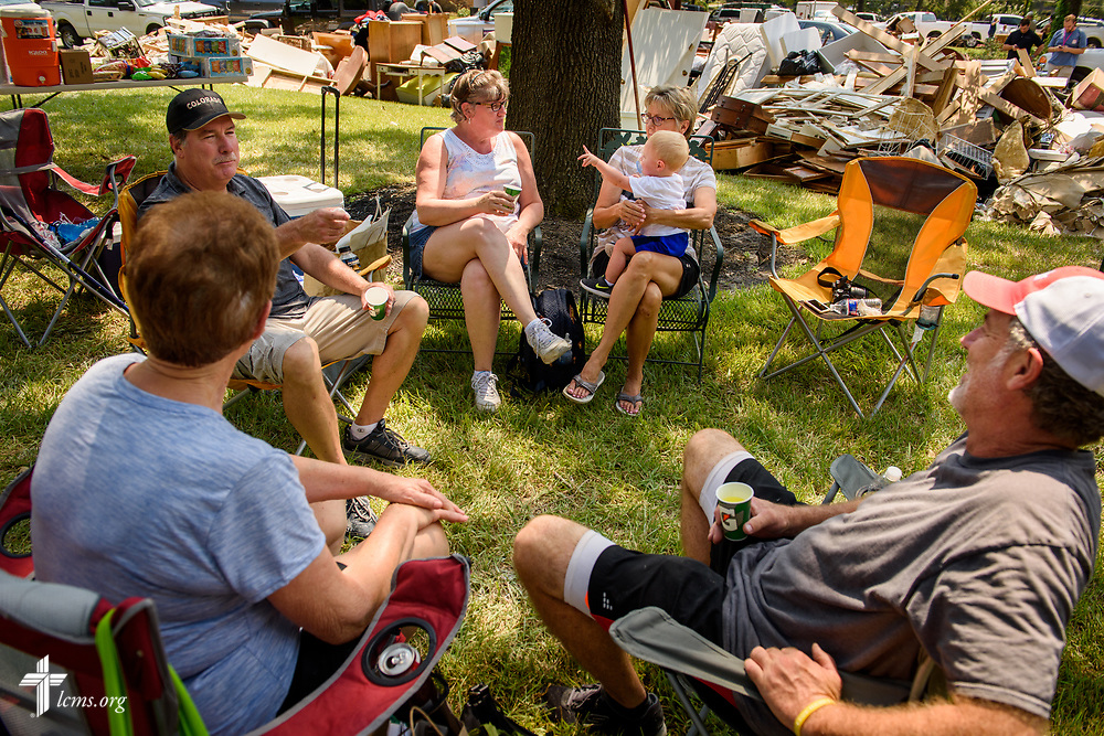 Family members and volunteers from Trinity Klein Lutheran Church, Spring, Texas, break together from cleanup at a home in Spring on Saturday, Sept. 2, 2017, following damage from Hurricane Harvey the previous week. LCMS Communications/Erik M. Lunsford