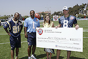 Award ceremony and check presentation from Bonnie Bernstein to Matt Hasselbeck, with Warren Moon and Torry Holt. NFL players participated in the 2004 NFL Quarterback Challenge in Santa Monica, CA on 04/24/2004. ©Paul Anthony Spinelli