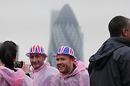 People collect on the side of the river Thames to watch the flotilla celebrating the Queen's Diamond Jubilee 3/06/2012