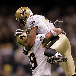2009 October 18: New Orleans Saints wide receiver Marques Colston (12) celebrates with tight end Jeremy Shockey (88) during the first quarter against the New York Giants at the Louisiana Superdome in New Orleans, Louisiana.