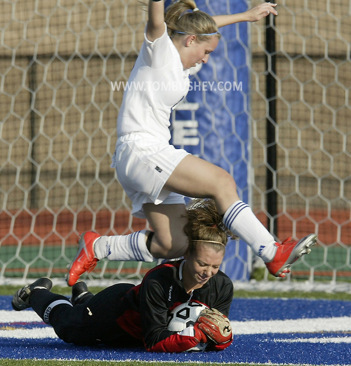 Middletown's Jessica Mann leaps over Kingston goalie Kiley Markes during a game in Middletown on Wednesday, Oct. 21, 2009.