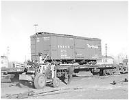 Box car #3173 on standard gauge flat car X4421.<br /> D&RGW  Alamosa, CO  Taken by Richardson, Robert W. - 12/14/1955