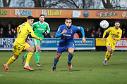 AFC Wimbledon defender Rod McDonald (4) chasing the ball in the box during the EFL Sky Bet League 1 match between AFC Wimbledon and Fleetwood Town at the Cherry Red Records Stadium, Kingston, England on 8 February 2020.