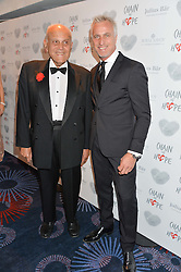 Left to right, SIR MAGDI YACOUB and DAVID GINOLA at the Chain of Hope Gala Ball held at The Grosvenor House Hotel, Park Lane, London on 18th November 2016.