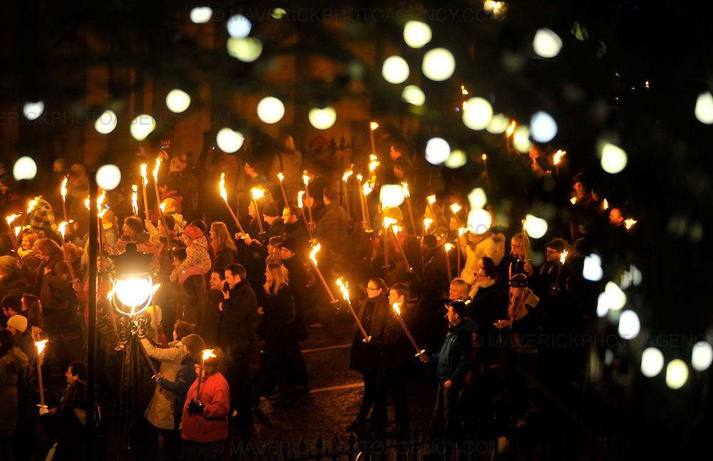 EDINBURGH, UK - 30th December 2010:  Edinburgh kicks off its Hogmanay celebrations with thousands of people joining in a torchlit procession creating a river of fire through the city from the historic Royal Mile to the fireworks finale on Calton Hill.  Pictured torch bearers parade down the Mound.  (Photograph: Callum Bennetts/MAVERICK)