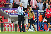 Arsenal Manager Arsene Wenger and Mesut Özil of Arsenal after the Barclays Premier League match between Crystal Palace and Arsenal at Selhurst Park, London, England on 16 August 2015. Photo by Ellie Hoad.