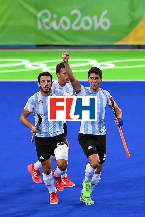 Argentina's Ignacio Ortiz (R) celebrates a goal during the men's Gold medal field hockey Belgium vs Argentina match of the Rio 2016 Olympics Games at the Olympic Hockey Centre in Rio de Janeiro on August 18, 2016. / AFP / MANAN VATSYAYANA        (Photo credit should read MANAN VATSYAYANA/AFP/Getty Images)