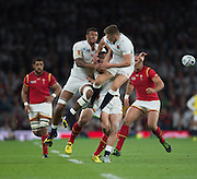 Twickenham, Great Britain,left , Courtney LAWES, middle, Jonny MAY and right Owen FARRELL contest the same high ball during the Pool A Game, England vs Wales.  2015 Rugby World Cup, Venue, The RFU Stadium, Twickenham, Surrey, ENGLAND. Saturday   26/09/2015  [Mandatory Credit; Peter Spurrier/Intersport-images]