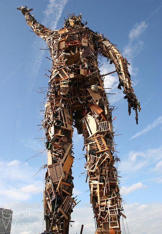 Anthony Gormley's 25-metre high Waste Man statue towers above Margate seafront on the Exodus film set