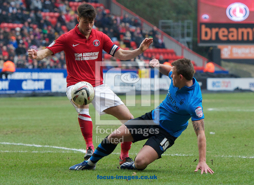 Picture by Alan Stanford/Focus Images Ltd +44 7915 056117.23/02/2013.Johnnie Jackson of Charlton Athletic is tackled by Simon Cox of Nottingham Forest during the npower Championship match at The Valley, London.