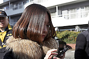 Japanese woman texting on her smart phone