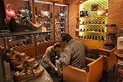 Men's shoe shop inside a department store in Marunouchi area of Tokyo.