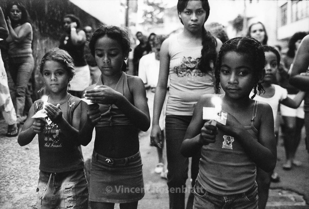 Procission for Saint Sebastian, during Epiphany festivities, in favela Santa Marta, south zone of Rio de Janeiro.. ||.Procissão homenageando São Sebastião, durante a Folha dos reis, na favela Santa Marta, zona sul do Rio de Janeiro.