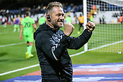 Forest Green Rovers assistant manager, Scott Lindsey celebrates with the fans at the end of the match during the EFL Sky Bet League 2 match between Cambridge United and Forest Green Rovers at the Cambs Glass Stadium, Cambridge, England on 2 October 2018.
