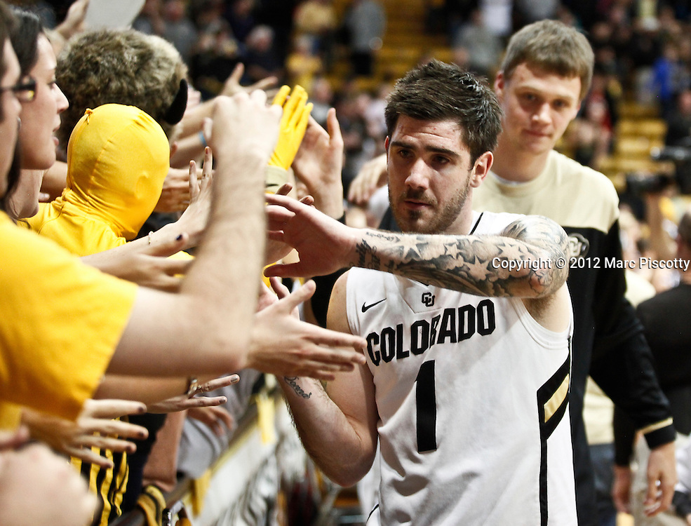 SHOT 1/21/12 7:10:36 PM - Colorado's Nate Tomlinson #1 high fives fans after beating Arizona during their PAC 12 regular season men's basketball game at the Coors Events Center in Boulder, Co. Colorado won the game 64-63..(Photo by Marc Piscotty / © 2012)