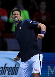 Serbia's Novak Djokovic celebrates winning his match against Austria's Dominic Thiem during day one of the Barclays ATP World Tour Finals at The O2, London.