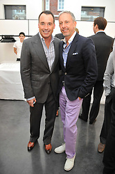 Left to right, DAVID FURNISH and PATRICK COX at a private view of photographs by Herb Ritts held at Hamiltons Gallery, 13 Carlos Place, London on 21st June 2011.