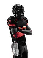 one american football player standing arms crossed in silhouette shadow on white background
